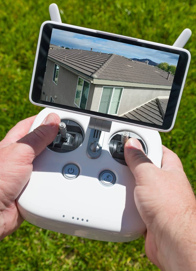 home inspector holding drone controller